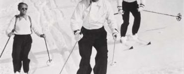 Ski school head Sigi Engl takes Gary Cooper and Clark Gable down Dollar Mountain